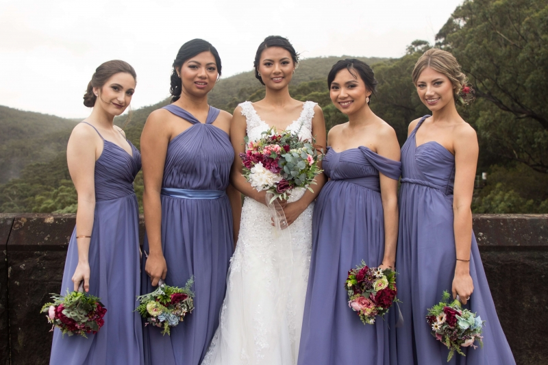 Stunning Bride with her bridesmaids in blue-min