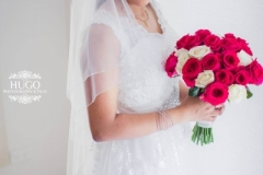 Bride Diane holding red roses
